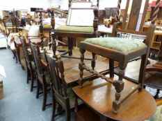 AN OAK DRAW LEAF DINING TABLE AND SIX SIMILAR OAK DINING CHAIRS.