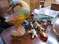 A LARGE CARVED DUCK FIGURE AND OTHER ANIMAL ORNAMENTS.