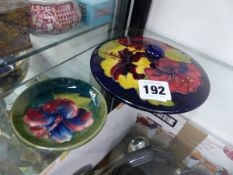 AN EARLY MOORCROFT PIN DISH WITH ORIGINAL LABEL AND A MOORCROFT LID.