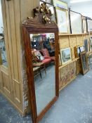 A LARGE DECORATIVE WALL MIRROR.