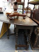 AN OAK DROP LEAF GATELEG TABLE AND A SIMILAR TEA TROLLEY.