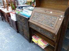 AN ANTIQUE CARVED OAK STUDENT'S BUREAU TOGETHER WITH A SMALL OAK CABINET AND A LOW MAHOGANY