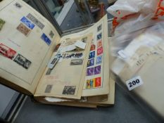 A STAMP ALBUM, LOOSE STAMPS, FIRST DAY COVERS, ETC.
