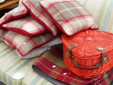 A SET OF GOOD QUALITY CUSHIONS, A HAMPER AND A WOVEN RUG.