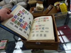1000'S OF PRE 1950'S STAMPS IN A MASSIVE GLOBAL STAMP ALBUM.
