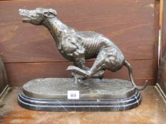 A BRONZE FIGURE OF A RACING GREYHOUND SIGNED JAMES OSBORNE.