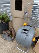 A HOSE REEL, A SACK TRUCK AND A GARDEN ORNAMENT.