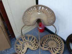 THREE ANTIQUE TRACTOR SEATS TO INCLUDE HOWARD, MARTIN AND BAMFORDS.