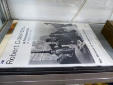 A ROBERT DOISNEAU EXHIBITION POSTER AND A KORE ADDIDAS FOLIO OF PRINTS.