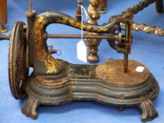 AN ANTIQUE SEWING MACHINE.
