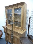 AN ANTIQUE PINE DRESSER WITH GLAZED CABINET ABOVE.