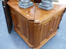 A PAIR OF PINE CORNER CABINETS.