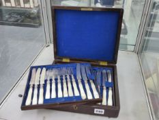 A CASED SET OF CUTLERY WITH MOTHER OF PEARL HANDLES.
