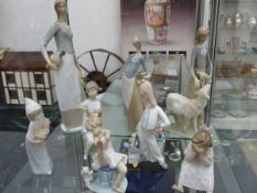EIGHT PORCELAIN FIGURES VARIOUSLY STAMPED LLADRO AND OTHERS.