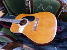 A HARMONY SEMI ACCOUSTIC GUITAR WITH CASE.