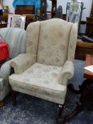 A WING BACK ARMCHAIR.