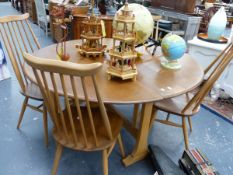 AN ERCOL DROP LEAF DINING TABLE AND FOUR HIGH BACK CHAIRS.