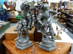 A PAIR OF VINTAGE LARGE CAST METAL FIGURES OF ARMOURED KNIGHTS.