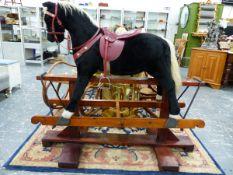 A LARGE BESPOKE UPHOLSTERED ROCKING HORSE.