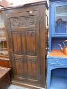 A CARVED OAK HALL CUPBOARD.