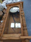 A VICTORIAN PINE WALL CLOCK.