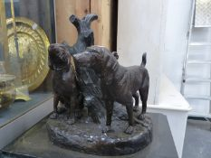 A CAST BRONZE FIGURE TWO SPORTING DOGS BY TREE STUMP ON MARBLE PLINTH.