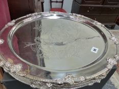 A SET OF FOUR LARGE PLATED TRAYS.