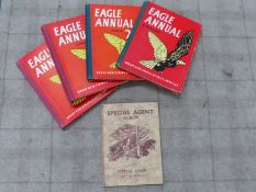 FOUR EAGLE ANNUALS IN RED AND A POSTAGE STAMPS OF THE WORLD SPECIAL AGENT ALBUM.