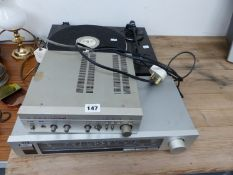 A TECHNICS RECORD DECK AND AN AIWA AMPLIFIER.