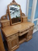 A VICTORIAN PINE DRESSING TABLE.