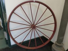 A LARGE PAIR OF CAST IRON WAGON WHEELS.