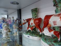 A PAIR OF LARGE ANTIQUE STAFFORDSHIRE SPILL VASES AND OTHER ORNAMENTS.