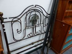AN ANTIQUE WROUGHT IRON BED.