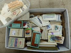 A QUANTITY OF LOOSE CIGARETTE CARDS AND EMPTY BOXES, A SMALL AMOUNT OF POSTCARDS,TRAIN TICKETS AND