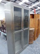 A BRUSHED STAINLESS STEEL DISPLAY CABINET.