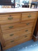AN EDWARDIAN SATINWOOD CHEST OF DRAWERS.