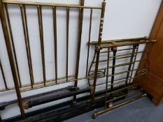 A PAIR OF EDWARDIAN BRASS SINGLE BEDS.