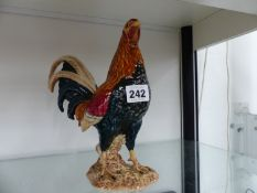 A BESWICK ENGLAND ROOSTER, NUMBER 2059.