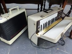 A JONES SEWING MACHINE AND A VINTAGE ELECTRIC ORGAN.