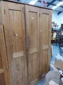 AN ANTIQUE PINE SCULLERY CABINET.