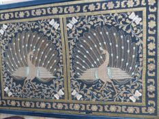 A LARGE EASTERN FRAMED TEXTILE WITH METAL THREADWORK.