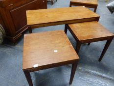 A MID CENTURY TEAK LOW COFFEE TABLE TOGETHER WITH A PAIR OF MATCHING NESTING TABLES.