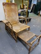AN ANTIQUE BAMBOO CONSERVATORY CHAIR WITH ADJUSTABLE BACK AND FOOTREST.