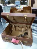 A CANVAS COVERED LEATHER DRESSING CASE CONTAINING SOME ELECTROPLATE FORKS. W 44cms.