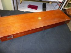 A MAHOGANY GUN CASE WITH DIVISIONS FOR A MUZZLE LOADING SHOTGUN AND TOOLED LEATHER CARRYING CASE (