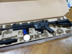 AN AIRSOFT- ELECTRONIC BB AUTO LOADING RIFLE. BOXED.