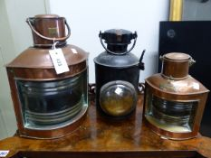 A VINTAGE RAILWAY SIGNAL LAMP TOGETHER WITH TWO COPPER SHIP'S LANTERNS. (3)