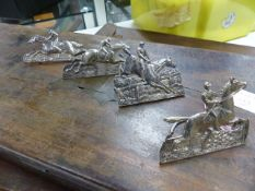 A SET OF FOUR VICTORIAN SILVER HALLMARKED NAME CARD HOLDERS DEPICTING HORSE AND JOCKEY SCENES, DATED