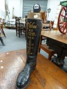 A VINTAGE LEATHER RIDING BOOT WITH HAND PAINTED ADVERTISING ELTHEA-R.E.TRICKER & Co SHOE AND BOOT