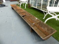 A GROUP OF FIVE ANTIQUE CAST IRON FEED TROUGHS.